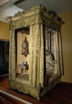 This four-poster bed is a prestige-piece made for a state room. In the early eighteenth century, this was the kind of bedstead an aristocrat would acquire. The style is in imitation of the French kingLouis XIV, who received guests while lying in bed. Originally, this four-poster bed stood in Eerde Castle, near Ommen. It is made of wood and covered with costly silk materials. The curtains, the cornice and the pelmets are European damask while the embroidered material of the headboard and…