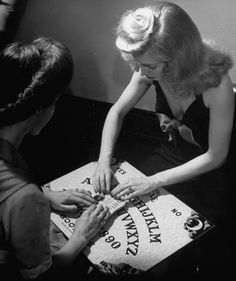 """Wallace Kirkland, """"Young people playing with a Ouija Board,"""" June, 1944."""