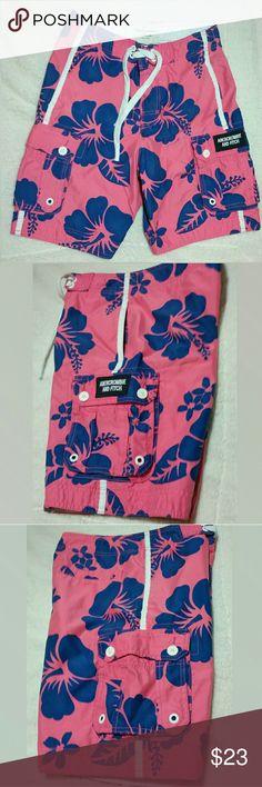 Abercrombie & Fitch Swim Trunks/Board Shorts Hawaiian print swim trunks/board shorts in bright, summer colors. Bubblegum pink/cobalt navy blue. Velcro/lace up front, mesh lined, 5 pockets- 2 reg pockets, w cargo, & 1 back pocket. Size XS. Great condition Abercrombie & Fitch Swim