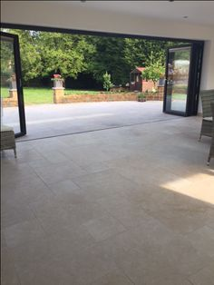 Our Chambolle limestone takes the inside outside with a seamless transition from the kithen/diner to the patio www. You are in the right place about flooring diy Here we offer you the Outside Tiles, Outside Flooring, Outside Patio, Inside Outside, Outdoor Flooring, Limestone Patio, Limestone Flooring, Open Plan Kitchen Living Room, Kitchen Doors