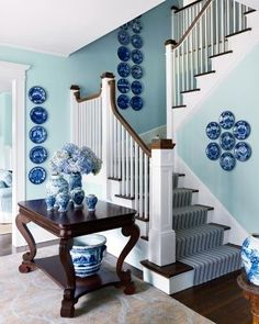 Oh-my-freaking-goodness, a turquoise and blue foyer and stairway straight out of my dreams covered in...