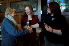 Dollars, data support record number of transgender U.S. election candidates - February 11, 2018.  Democratic candidate for the U.S. Congress Alexandra Chandler introduces her wife Cathy to a voter before the Greater Haverhill Indivisible candidates forum in Haverhill