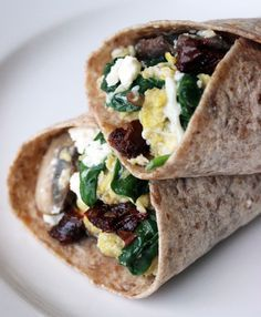 Egg wrap! Mushrooms, spinach, eggs and feta cheese. I chose not to use sundried tomatoes.