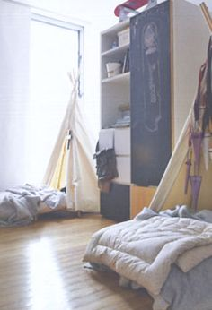 Tents form a cute canopy over the kids beds Kids Bedroom Ideas For Girls Toddler, Kids Rooms, Teepee Bed, Bed Canopies, Canopy, Tent Over Bed, Ladybug Room, Baby Tent, London Decor