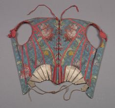 18th Century Mid.  Corset, or  Stays.       Blue background with floral print and red trim.      art.famsf.org suzilove.com