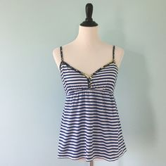 Aero Striped Tank Aeropostale blue and white striped tank top. Floral trim on straps. Size large, but fits a little small, so it's more like a medium. Aeropostale Tops Tank Tops