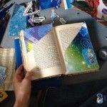Viele Schnipsel liegen um die Doppelseite des alten Buches, das ein Poesiealbum werden soll: das A&O beginnt zu basteln ... heraus kommt ein Hidden Poem voller #journaling und #upcycling Power. See the result on my blog by clicking the image.
