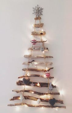 It's December aka officially Christmas time! Leave it to Brogan, our photographer/resident DIY specialist, to create the coolest Christmas tree we've ever seen. Her unique hanging tree made of . Wall Hanging Christmas Tree, Driftwood Christmas Tree, Wooden Christmas Trees, Xmas Tree, Christmas Lights, Christmas Time, Christmas Decorations, Driftwood Crafts, Driftwood Ideas