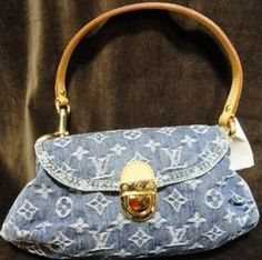 Louis Vuitton Pre-Owned Mini Denim Monogram Handbag with Buckle in the front, Leather is like new!    Original Retail : $830.00  Our Price : $455.35