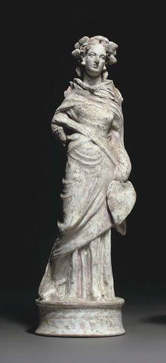 A HELLENISTIC TERRACOTTA FEMALE FIGURE -  CANOSAN, CIRCA 3RD CENTURY B.C.
