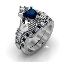 Now, that's a proper Claddagh Ring.    I would not complain to get that as an anniversary gift.  OMG, it's LOVELY!!!  925 Sterling Silver Engagement / Wedding Bridal Ring Set With Dark Blue CZ Inlaid - USD $129.95