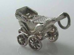 pram charm with moveable wheels