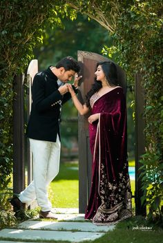 Bride with wine embroidered Sabyasachi saree . Ecstatic Resort Wedding of a Classy Couple in Desi Indian Wedding Couple Photography, Couple Photography Poses, Romantic Couples Photography, Photography Styles, Couple Wedding Dress, Wedding Couples, Engagement Couple Dress, Engagement Saree, Indian Engagement