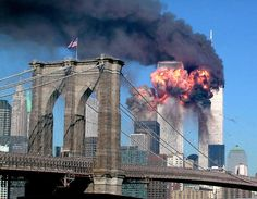 An image of 9-11- w/Old Glory flying from the Brooklyn Bridge. We will never forget!