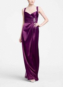 This sensationalsleeveless charmuese gown is both elegant and timeless!  Sleeveless charmuese bodice features chiffon waist.  Waist embellishment features stunning sliver and dyed to match beading  Criss cross open back adds drama to this already beautiful ensemble.  Cascading side twist detail creating a flattering silhouette.  Fully lined. Side zip. Imported polyester. Dry clean.