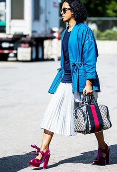 A pleated skirt is paired with a denim jacket and velvet platform heels.