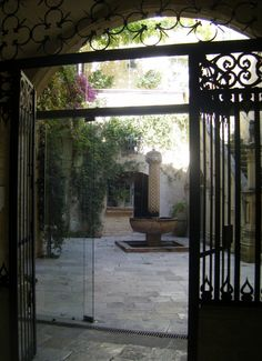 I love the gate idea. Ooh and a courtyard would be amazing!