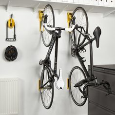 Go-Go-Gadget! Cycloc Endo Bike Storage - The Endo is a vertical bike storage system that gets your b Bike Storage Uk, Wall Mounted Bike Storage, Bike Storage Systems, Vertical Bike Storage, Bike Storage Apartment, Bike Storage Solutions, Garage Storage, Storage Rack, Bike Storage Office