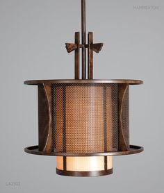 Our finest Contemporary Collection embraces the bold elegance and reassuring warmth of our traditional designs with modern geometries, sophisticated lines, and distinctive urban influences. Shown here, an Asian inspired drum pendant with hand sculpted details, a Tiko weave diffuser and a River Rust finish.