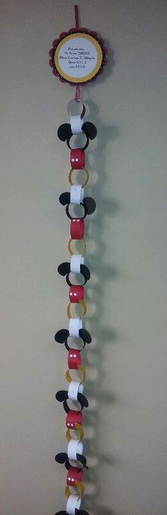 Countdown to Disney Calendar for vacation trip to Disney World or Disneyland from Get Away Today. Paper chain with alternated Mickey Mouse themed rings. Each ring has a Disney themed idea you can do as a family that day to get kids excited for their trip. I need to remember this for next time!! Or could just use it for party garland!!!! @Jen Stotz @Heather Pfister @Annie Suh Chang