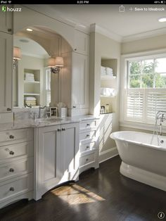 TA I like the window treatment, with top segment open, lots of light. / arches on mirror and baseboards of cabinetry.