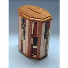 Tzedakkah Box- Eight Panels  $198.00 Etz-Ron's eight sided Tzedakah Box (charity box) adorned with 8 panels of wooden mosaics and more detail work on top and bottom panels. Choose color. Etz-Ron's best selling home Tzedakkah Box.  Item #  tze-m8    Dimensions:   5.5 x 3.5 x 5.1H'  Material:  wood, brass