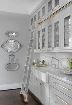 Grey butler's pantry with brass hardware | Mitchell Wall Architecture & Design