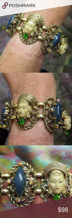 Rare Signed Selro Thai Girl Figural Link Bracelet Fabulous vintage Selro Selini designer bracelet ~ all of the bells and whistles. Asian face is three dimensional with dangle hoop earrings, gold headdress, hand-painted features and a green prong set crystal rhinestone. Alternating links have a jade green cabochon surrounded by Northern Lights Aurora Borealis.  All are layered on an ornate gold tone metal base. Rare piece because almost all others have faux pearl accents and are not signed…