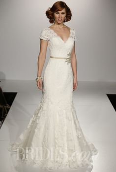 """Brides.com: Maggie Sottero - Fall 2013. """"Veda"""" lace trumpet gown with v-neckline and lace overlay short sleeves, Maggie Sottero"""