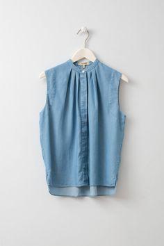 Fedora Sleeveless Shirt with High Neck Sleeveless blue shirt with a high neck from Swedish designer Whyred.