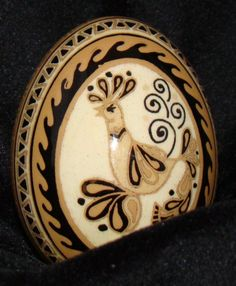 pysanky on brown egg