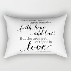 Fashionable throw pillow with black and white typographic design of 1 Corinthians 13:13, And now these three remain: faith, hope, and love. But