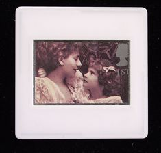 This photograph by Alice Hughes was taken in 1899 and is printed as one of the set of ten Royal Mail postage stamps called 'Greetings Clown' issued in 1995. The unused stamp is titled 'Alice Keppel with her Daughter Violet'. The wonderful image of mother and daughter is encased in a vintage slide mount, with glass, making this a unique piece of jewellery.