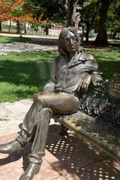 A life size statue of the Beatle, John Lennon. Sculpted by cuban artist Jose' Villa Soberon.  Sittin on a park bench in Habana, CUBA.