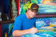 Drew Brophy painting Los Cabos Surfboard May 6 2014 PHOTO By Larry Beard Hinano RS