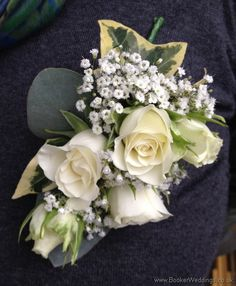 A gorgeous buttonhole to compliment any bride - ivory rose with gypsophila. | Booker Weddings are based in Liverpool, Merseyside and would be happy to quote for Weddings in Liverpool and surrounding areas. We are Wedding Flower specialists and have been specially selected to be one of Interflora's Vera Wang Wedding Florists.