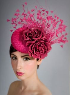 Pink rose and feather headpiece.