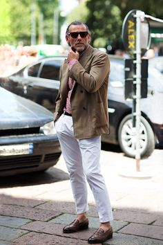Quintessential summer look: Red gingham shirt, white trousers and khaki sportscoat. via The Sartorialist