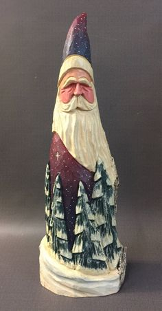 A personal favorite from my Etsy shop https://www.etsy.com/listing/558052981/hand-carved-original-santa-with-carved
