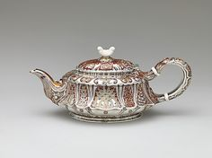 Teapot - Tiffany & Co. (1837–present)Date: ca. 1888 - Geography: Mid-Atlantic, New York City, New York, United States - Culture: American - Medium: silver, silver gilt, enamel and ivory - collection of The Metropolitan Museum of Art