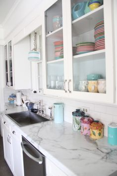 Budget Kitchen Makeover     -  Faux Marble Countertops Replaced the old Cabinet doors