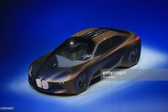 The BMW Vision Next 100 concept automobile is unveiled by Bayerische Motoren Werke AG (BMW) as the company celebrates its 100th anniversary in Munich, Germany, on Monday, March 7, 2016. BMW AG, which became the world's largest maker of luxury cars by focusing on Autobahn thrills, is shifting gears to automated driving as urbanization and changing attitudes toward cars redefine transportation. Photographer: Krisztian Bocsi/Bloomberg via Getty Images The