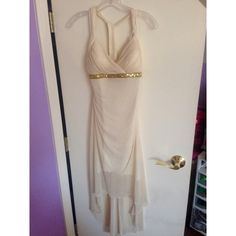 Beautiful White Gold Sparkly Dress White gold sparky dress. High low halter. Previously worn. Has a few spots on the outside and the inside. City Triangles Dresses High Low