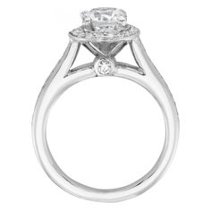 Light and feminine, yet bold and eye-catching: this affordable, vintage-style engagement ring from our halo collection features cathedral shoulders for a smooth transition between band and center setting. A lofted 1.03 carat Round Brilliant cut Diamond Simulant centerpiece is surrounded by a micro-set halo, lifted high above the band into the light. Subtle ribbed detailing on the edges enhances its romantic appeal. Center stone available in a range of sizes. See menu above. 39 round brill...
