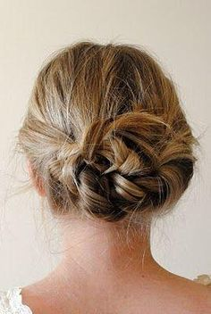 part hair down center. braid each pigtail back away from face. tie braids in a knot.-pin loose ends