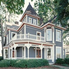 """Blue Victorian House...Pretty...~ D. Light Blue """"If your home is a showstopping Victorian, fresh color combinations like this light blue and red-brown interpretation can enhance fanciful architectural elements,"""" says Behr's Erika Woelfel. Seen here, Behr's Skipper (570F-5) and"""