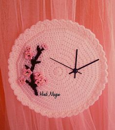 Crochet wall clock, with the movement off center