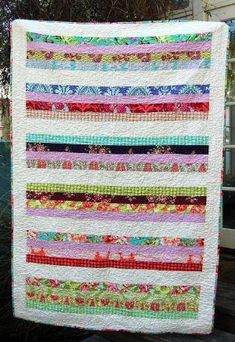 Very simple quilt but I love it! Using long strips of fabric, quilt pattern by esmeralda