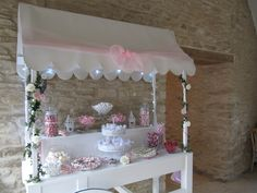 A shabby chic themed Candy Cart complete with 13 pieces of glasssware filled with sweets and a centrepiece display of sweetie filled favour bags.