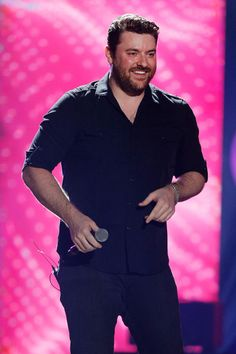 Chris Young Photos - Singer Chris Young performs onstage during the 2016…